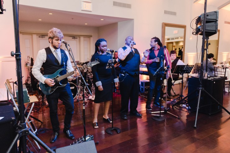 Broadsound band performing during wedding reception at Bride and groom dancing The Hora at Jewish wedding at Chesapeake Bay Beach Club.