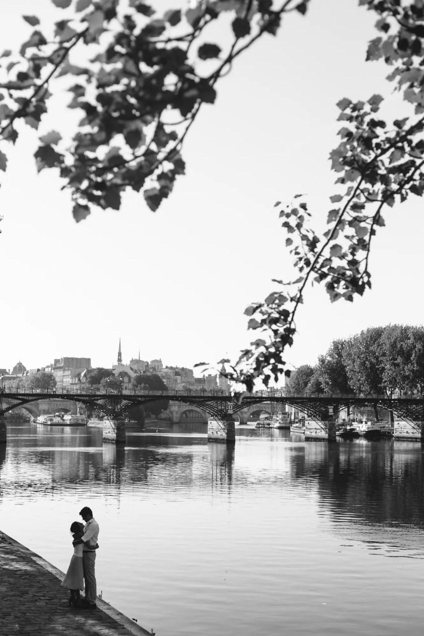 Couple Paris Seine Engagement black and white hug