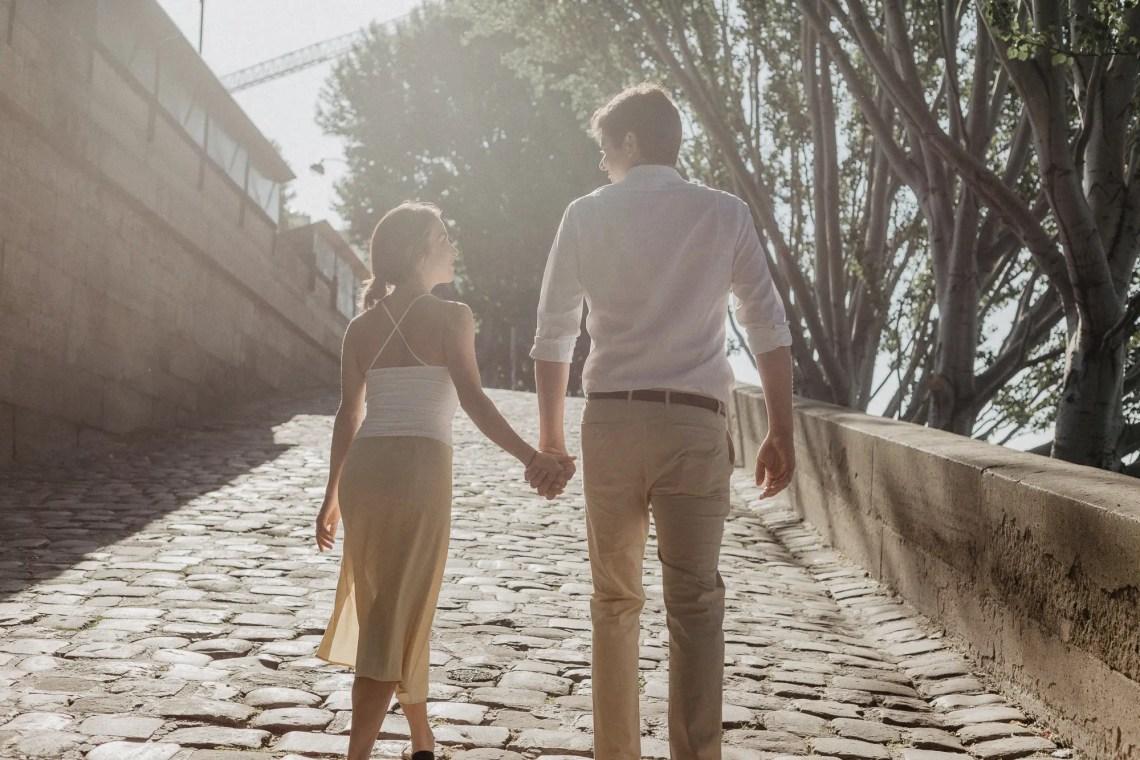 Couple Paris Seine Engagement holding hands sunrise