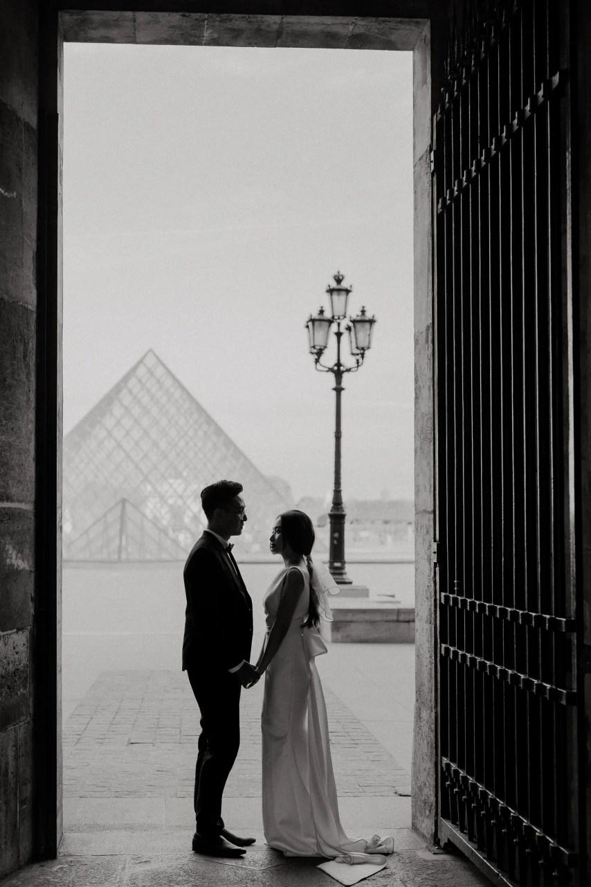 Engagement photo at the Louvre pyramid, Paris