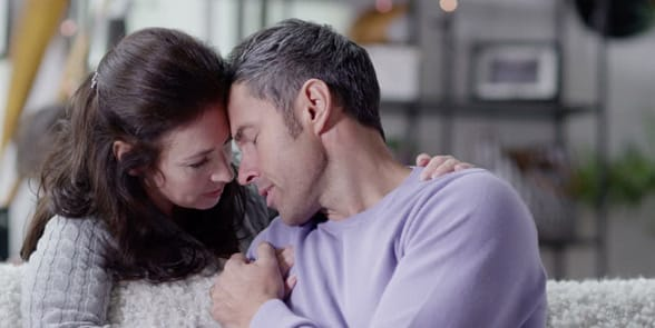Photo of a woman comforting a man