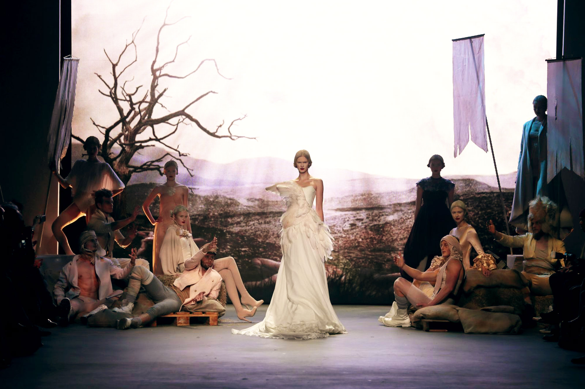 Dennis Diem Nightingale Daan Colijn backdrop visual fashion show Amsterdam fashion Week models war wasteland soldiers swan wedding dress tableau vivant