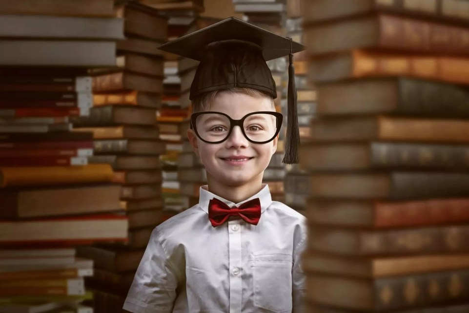 Child between piles of books
