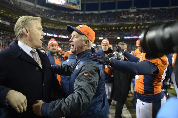 John Elway gets a hug from Denver Broncos head coach John Fox as the Denver Broncos took on the Kansas City Chiefs at Sports Authority Field at Mile High in Denver, Colorado on December 30, 2012. Joe Amon, The Denver Post