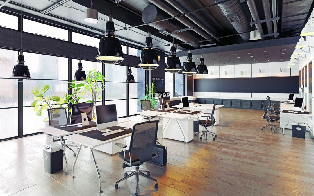 Modern spacious office well lit with wooden floor