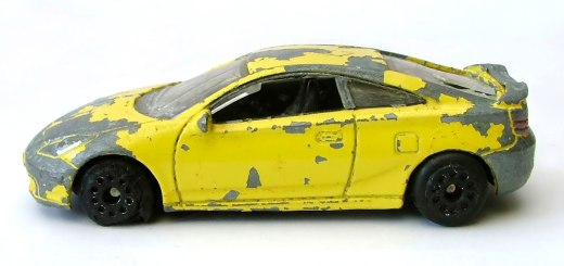 Beat up old children's toy car.