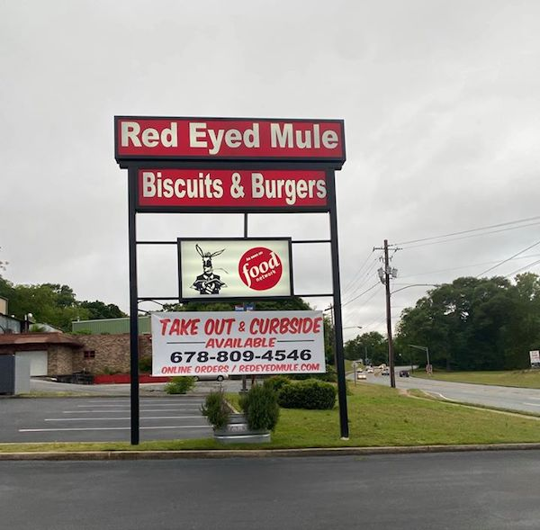 Exterior and sign for Red Eyed Mule