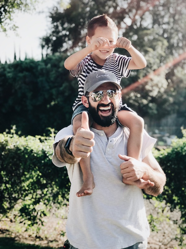 Boy on dad's shoulders