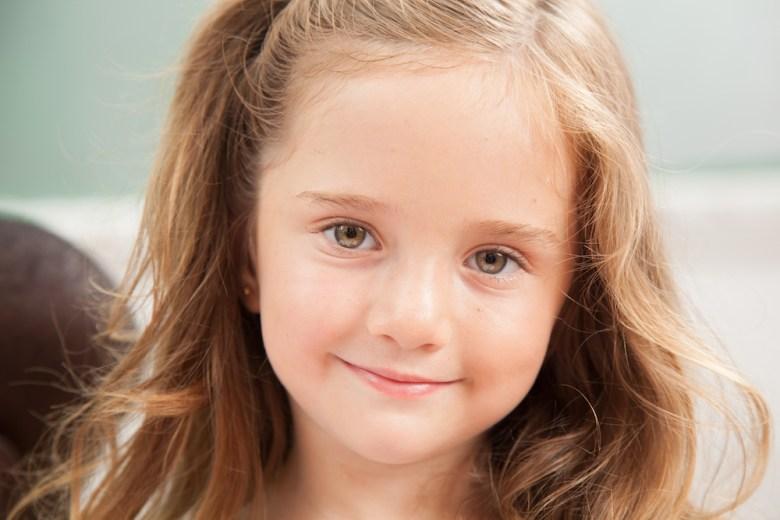 Kindergarten girl named Nora smiling
