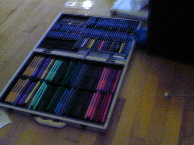 Image of an art kit with markers, pencil crayons and pastels