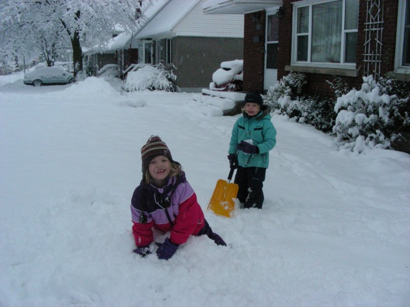 Image of two girls playing in the snow