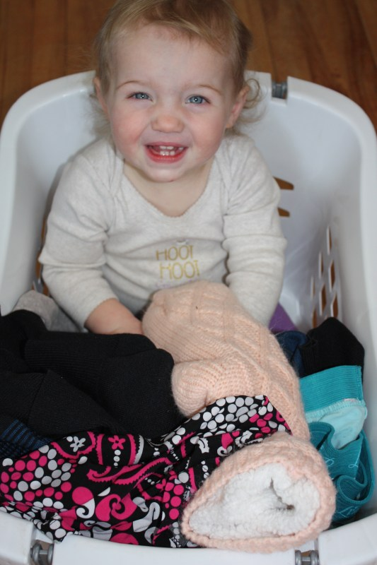 toddler in a laundry basket