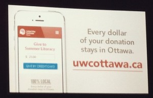 Image of a sign promoting www.uwottawa.ca to raise funds for literacy programs