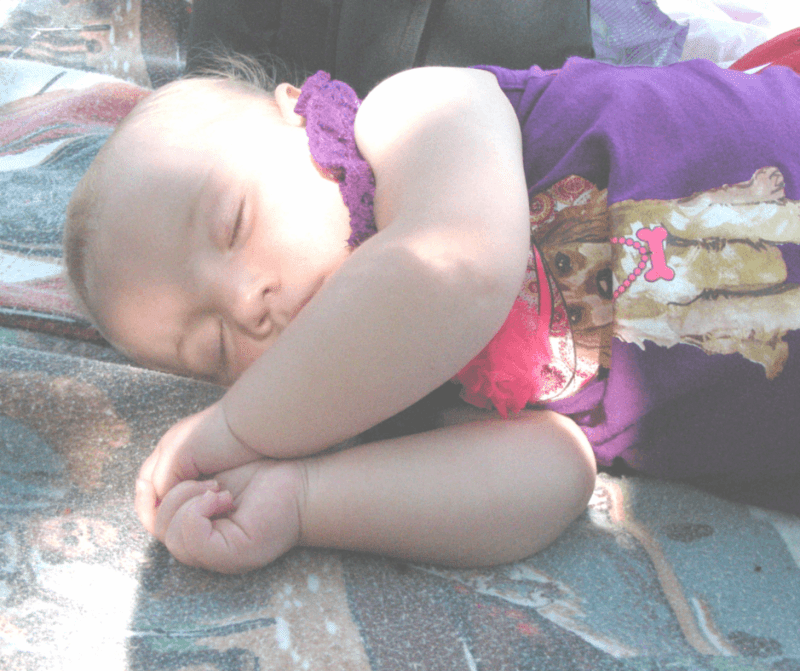 Image of a sleeping baby outdoors