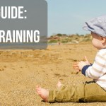 "Image of a toddler sitting on a beach with text ""Dad Guide: Potty Training"""
