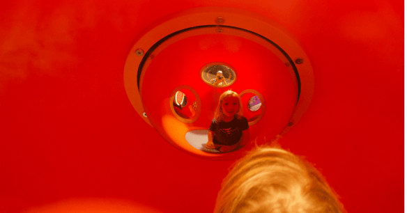 Child's image in a mirror at the Canada Museum of Science and Technology