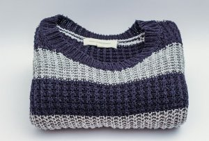 Adult sweater, folded
