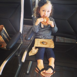 Ava eats breakfast at DULLES