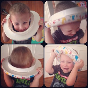 Charlie with toilet seat on head