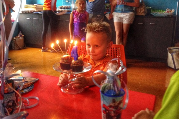 Charlie blows out candles