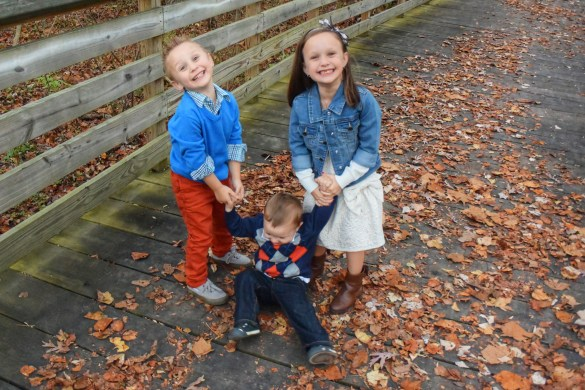 Ava and Charlie hold up Mason in tgiving TCP