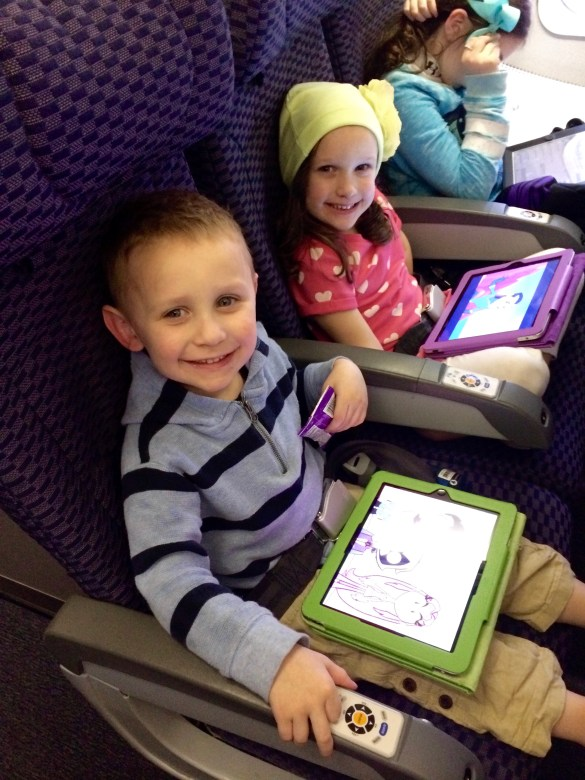 Kids with Ipads on plane