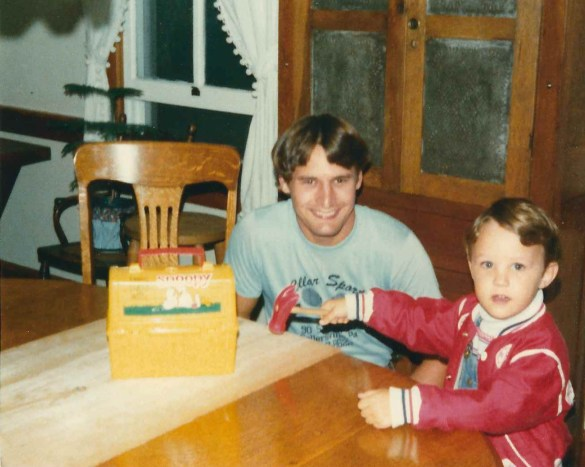 Dad and Adrian at table as a kid