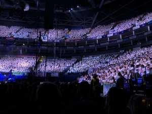 giant school choir singing at o2