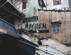 mayhem, painted on a run down building