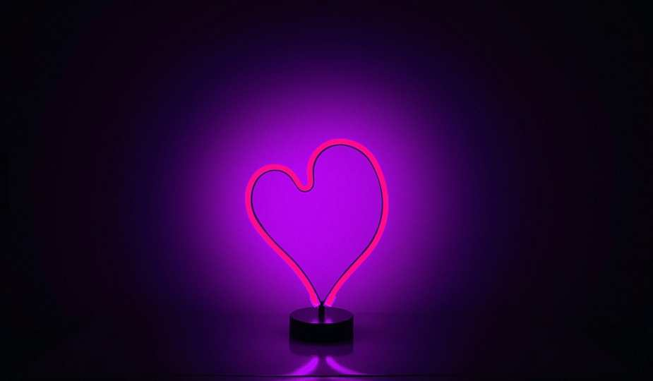 Neon light in heart shape and purple in colour