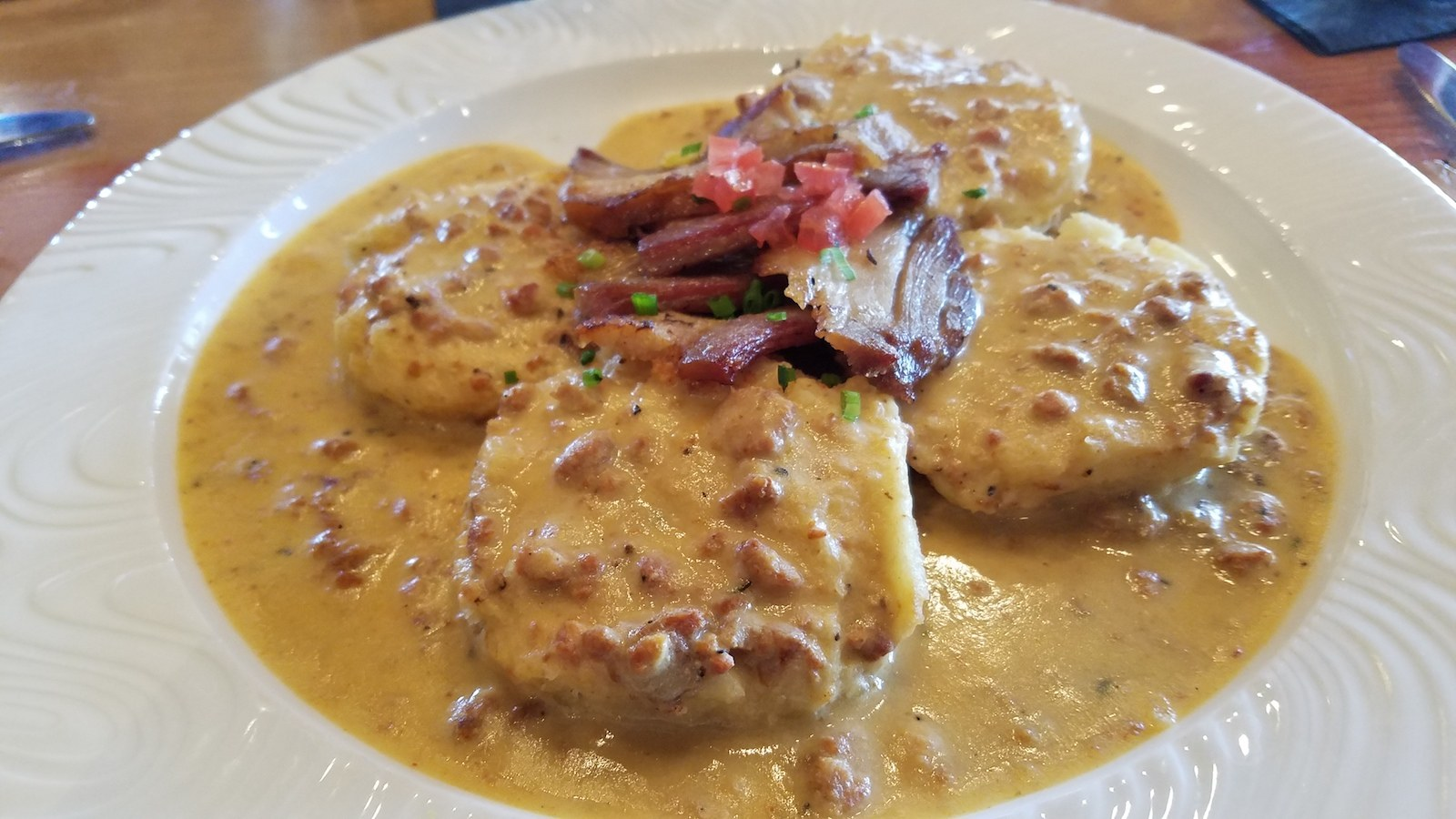 Soco Thornton Park Review - Fresh buttermilk biscuits and gravy with crispy pork belly