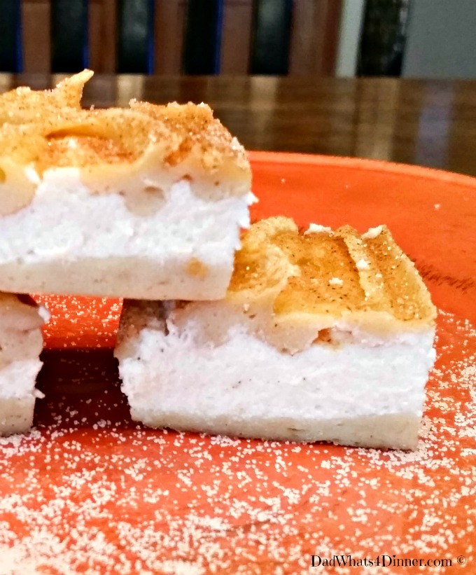 """My Churro Cheesecake Bars takes a festival favorite """"churro's"""" and turns it into a scrumptious cookie bar with a cheesecake filling."""