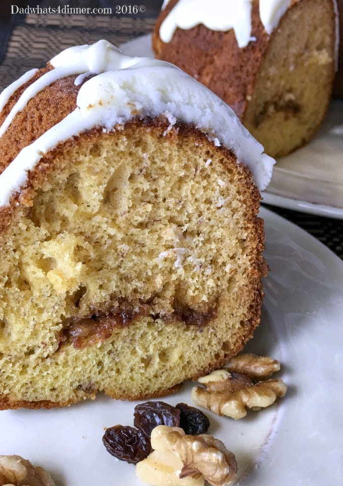 My Banana Streusel Coffee Cake is super moist with a sweet cream cheese frosting. Perfect for breakfast or dessert!