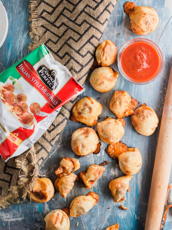 Meatball Marinara Bombs with pre-cooked Italian meatballs, pizza dough, mozzarella cheese and marinara sauce. Super fun snack idea, great for watch parties!