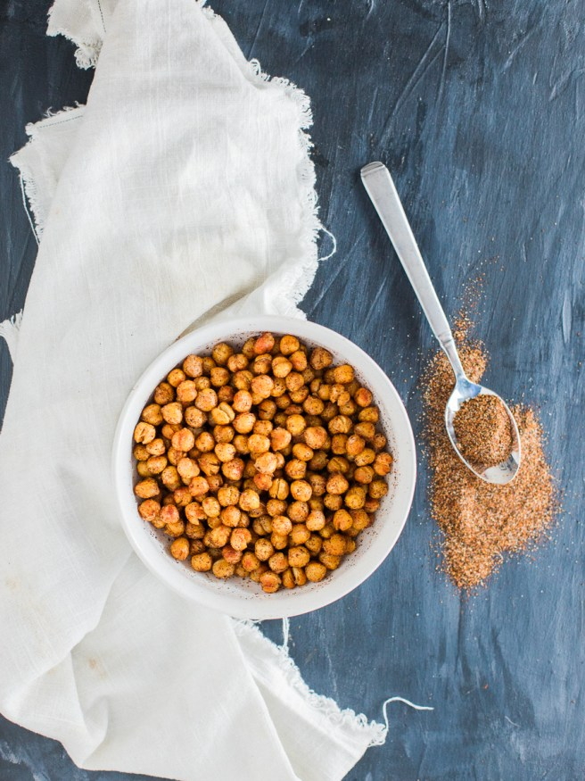 Roasted chickpeas with a from scratch chili seasoning. These roasted chickpeas taste amazing and are great to snack on when lounging around the house!