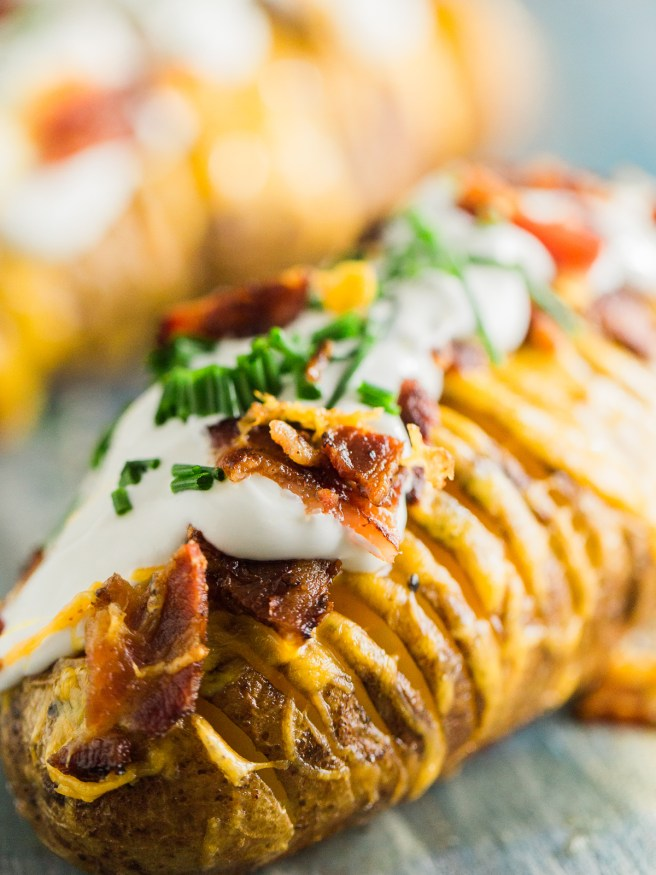 Hasselback potatoes loaded with cheese, bacon, sour cream, and fresh chopped chives, this is my new favorite way to have a baked potato!