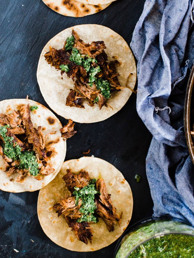 Grilled barbacoa tacos, cooked low and slow with a zesty chimichurri sauce. Barbacoa makes an excellent change to taco Tuesday! dadwithapan.com