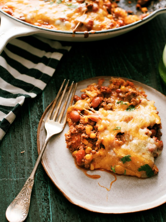 Tamale Pie is perfect comfort food! Ground beef beans,fire roasted corn with a taco seasoning, on top of cornbread and loaded with cheese.