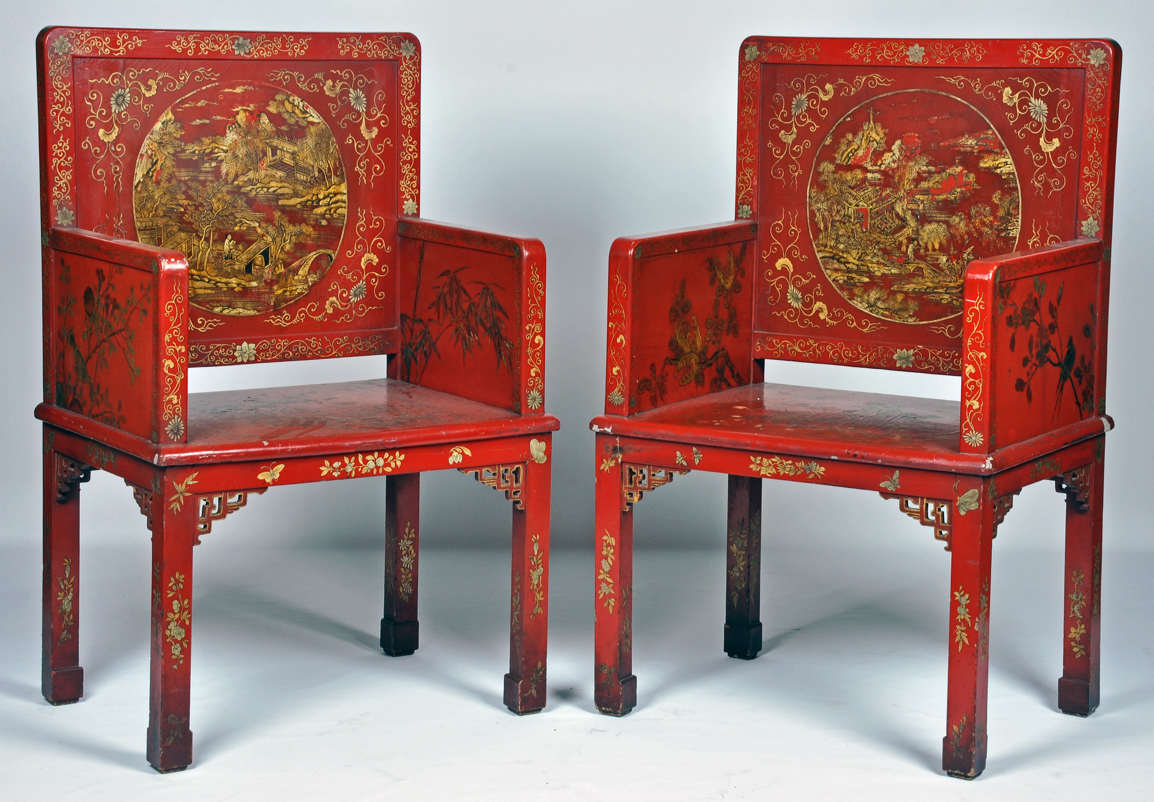 A Pair Of Chinese Parcel Gilt Decorated Red Lacquered Chairs