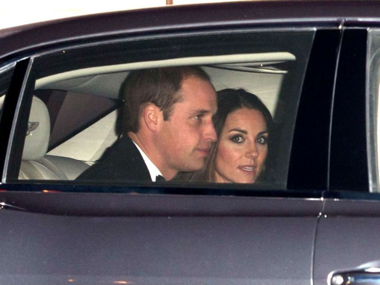 The Prince and Princess in a car.  They going to the mall?  You bet!