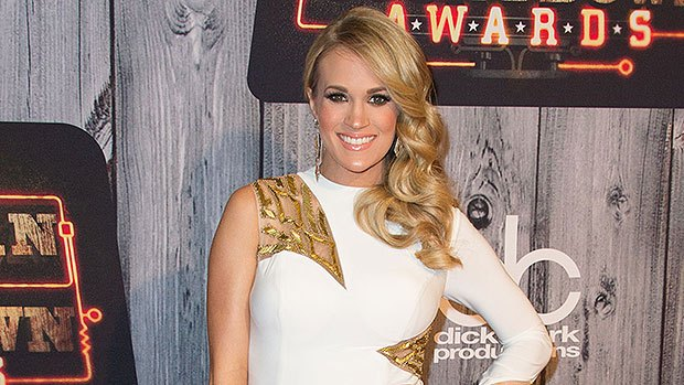 Carrie Underwood Sparkles In White Suit For CMT Awards Performance