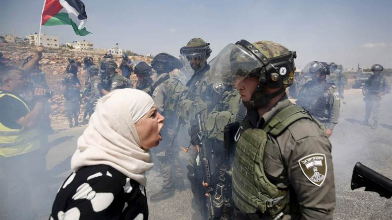 Feature Photo credit to NBC News Image: A Palestinian (Palestine) woman argues with an Israeli border policeman during a protest