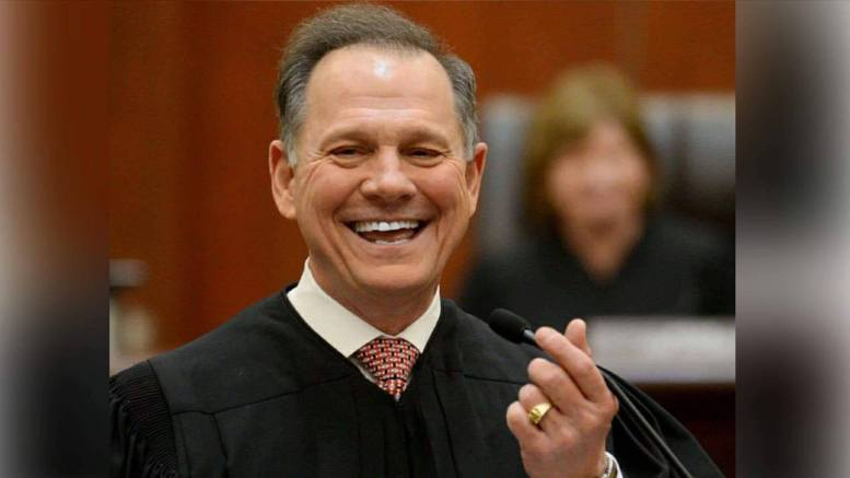 (Feature photo credit to screen capture and Dagger News Judge Roy Moore vindicated)