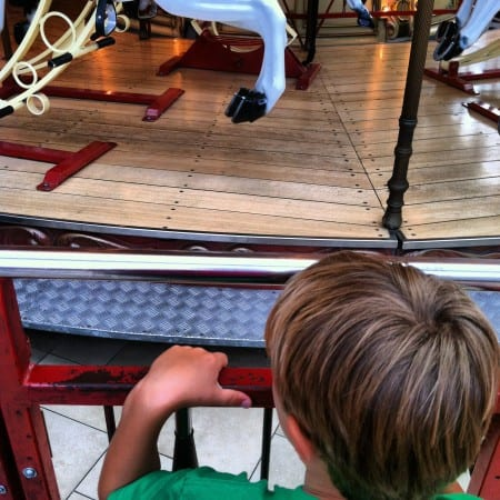 boy waiting to get on carousel