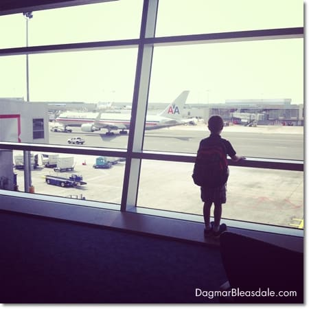 boy looking at airplanes at the airport