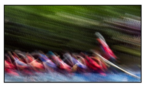 photo impressionistic image of dragon boat racers