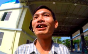 burmese man smiling bad teeth,man chewing tobacco beetnut chewing myanmar