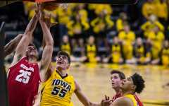 Garza, Cook slow Happ down, lead Hawkeyes to victory