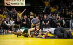 Iowa's six pins lead to pummeling of Michigan State