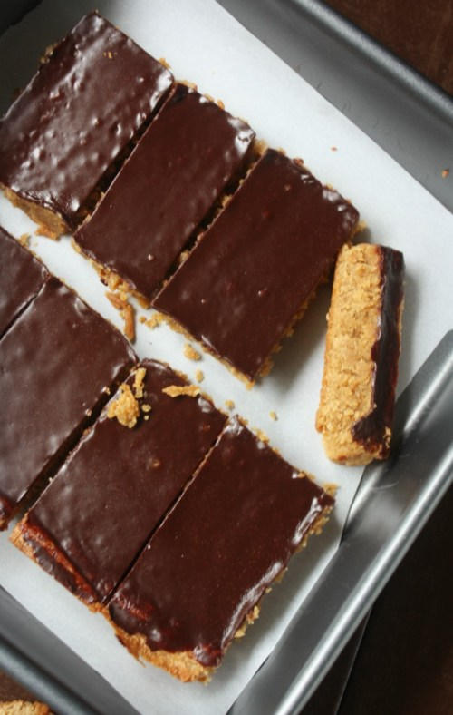 Chocolate Peanut Butter Bars are a delightful cake like cookie bar that is soft and will melt in your mouth. Topped with a thin layer of chocolate glaze.